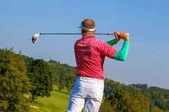 Man playing golf against blue sky Royalty Free Stock Photography