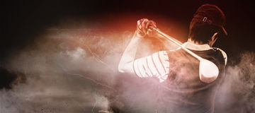 Composite image of man playing golf. Man playing golf against digitally generated image of color powder Stock Photography
