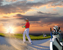 Man playing golf against sunset Royalty Free Stock Image