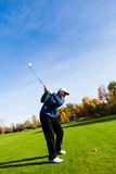Man playing golf. On a beautiful day Stock Photography