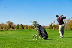 Man playing golf. On a beautiful day Royalty Free Stock Images