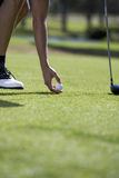 Man playing golf, close-up of feet on the tee Royalty Free Stock Photography