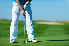 Man playing golf. Playing golf. Golf club and ball. Preparing to shot royalty free stock photos