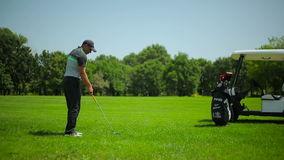 A man playing golf at the course stock footage