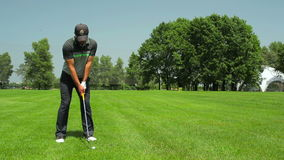 The man playing golf at the course stock footage