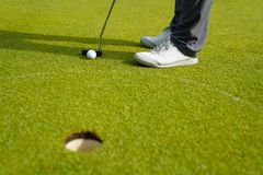 Man playing golf on a golf course in the sun, Golfers hit sweeping golf course in the summer stock images