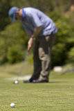 Man playing golf on a fresh green golf course Royalty Free Stock Photo