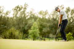 Man playing golf on the golf course Stock Photo