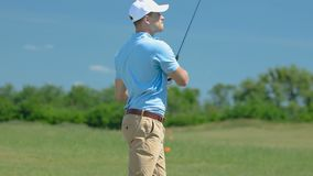 Man playing golf, making long-distance shot with driver on fairway, leisure. Stock footage stock footage