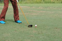 Man playing the golf in sport club. Close up man playing the golf in sport club Stock Image