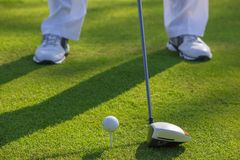 Man playing golf during sunny day Royalty Free Stock Image