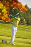 Man playing golf during sunny day Stock Image