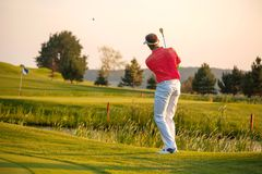 Man playing golf during sunny day Stock Photos