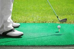 Man playing golf on teeing ground. In sunny day stock photo