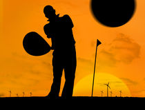 Man playing golf under the sunset Royalty Free Stock Photography