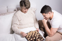 Man playing with grandmother Stock Photography