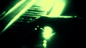 Man Playing a Green Particles Piano - Hands Close Up - Motion Background. Glowing Man Playing a Green Particles Piano - Hands Close Up - Motion Background stock video