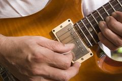 Man playing a guitar. A man playing a guitar Royalty Free Stock Photos