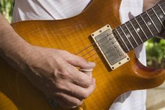 Man playing a guitar. A man playing a guitar Royalty Free Stock Photography
