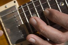 Man playing a guitar. A close up of a man playing a guitar Stock Photo