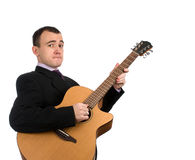 Man playing a guitar Stock Images