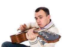 Man playing an guitar Stock Photography