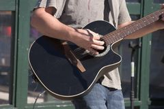 Man Playing guitar. Man Playing a Guitar Solo Outdoors royalty free stock photography