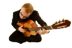 Man playing a guitar. Isolated on white background Royalty Free Stock Photos