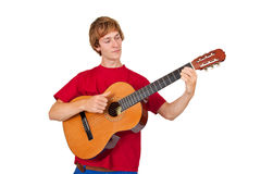 Man playing guitar. Young man playing on a guitar - isolated on white Royalty Free Stock Photo