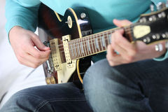 Man playing a guitar Stock Photography