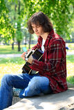 Man playing the guitar. Young man playing the guitar, outdoor Royalty Free Stock Photos