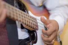 Man playing a Guitar. African american man playing a Guitar. With the focus on the hand Stock Image
