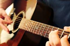 Man playing a guitar Stock Photo