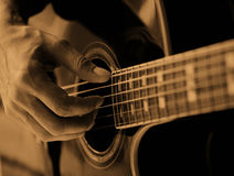 The man playing the guitar. Close up Royalty Free Stock Photo