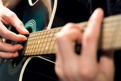 Man playing on the guitar Stock Photo
