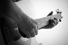 Man playing the guitar. Black and white picture of a man playing the guitar, shallow depth of field Royalty Free Stock Photo