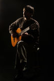 Man playing guitar classic guitarist Royalty Free Stock Images