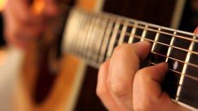 Man playing guitar close up stock footage