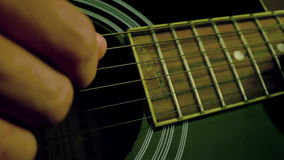 Man playing guitar close up stock video