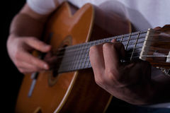 Man playing on guitar Stock Photography