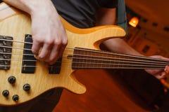 Man playing the guitar close-up royalty free stock image