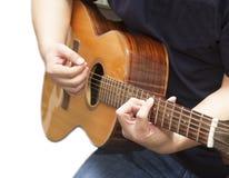 Man playing guitar closeup. Man strumming his guitar closeup royalty free stock image