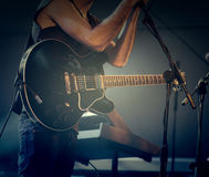 Man playing guitar. In concert, music and fun Stock Image