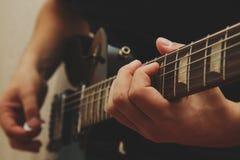 Man playing on guitar Royalty Free Stock Photo