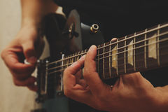 Man playing on guitar Royalty Free Stock Images