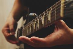 Man playing on guitar Stock Photo