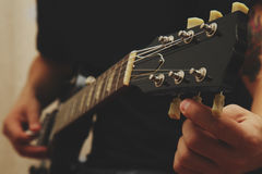 Man playing on guitar Stock Images