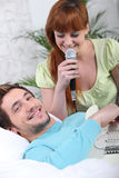 Man playing guitar for girlfriend Royalty Free Stock Image