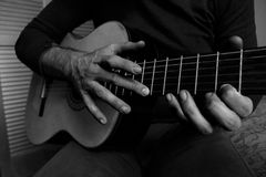 Man playing the guitar. Hand focus Royalty Free Stock Images
