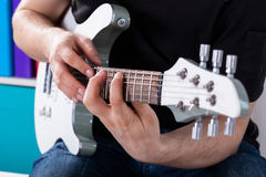 Man playing guitar his favourite song. Man playing the guitar his favourite rock song royalty free stock images